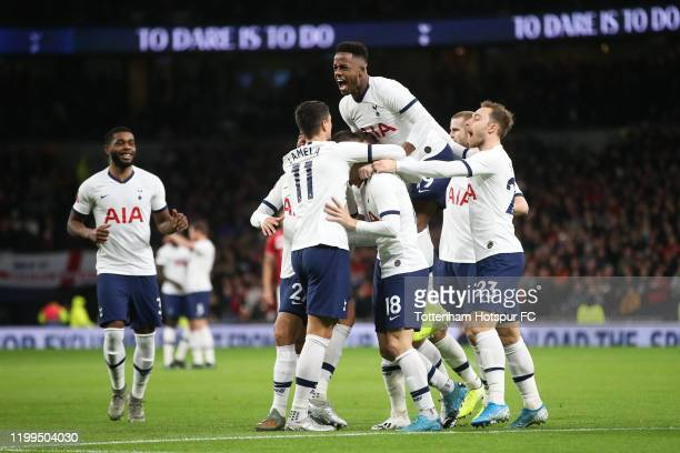 Tottenham Hotspur players celebrate after Giovani Lo Celso of Tottenham Hotspur scores his sides first goal during the FA Cup Third Round Replay...