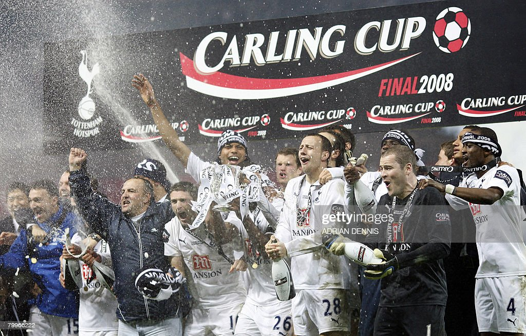 Tottenham Hotspur players celebrate after winning the Carling Cup Final against Chelsea at Wembley Stadium in London on February 24, 2008. Tottenham Hotspur won the game 2-1. AFP PHOTO ADRIAN DENNIS Mobile and website use of domestic English football pictures are subject to obtaining a Photographic End User Licence from Football DataCo Ltd Tel : +44 (0) 207 864 9121 or e-mail accreditations@football-dataco.com - applies to Premier and Football League matches.
