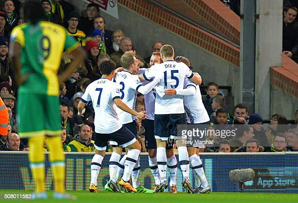 Tottenham Hotspur players celebrate their team's first goal by Dele Alli during the Barclays Premier League match between Norwich City and Tottenham...