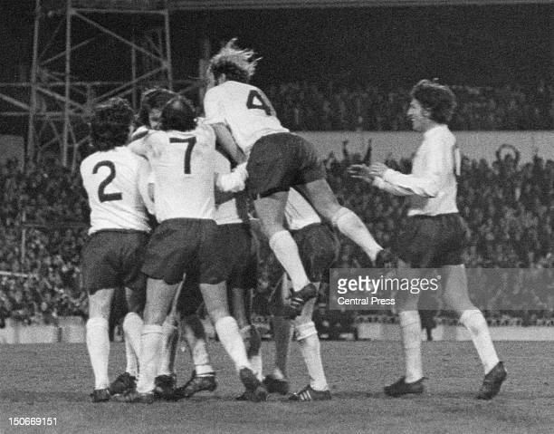 Tottenham Hotspur players congratulate Steve Perryman after his second goal against AC Milan in the UEFA Cup semifinal first leg at White Hart Lane...
