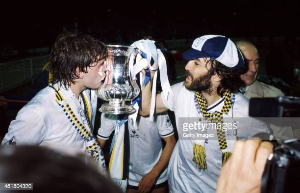Tottenham Hotspur players Glenn Hoddle and Ricky Villa celebrate with the FACup trophy after Tottenham Hotspur had beaten Manchester City in the 1981...