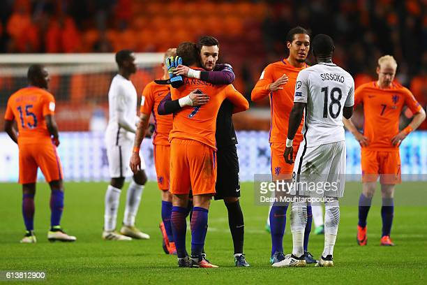Tottenham Hotspur players Hugo Lloris of France and Vincent Janssen of the Netherlands embrace after the FIFA 2018 World Cup Qualifier between...