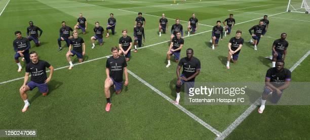 Tottenham Hotspur players kneel in support of Black Lives Matter at Tottenham Hotspur Training Centre on June 17, 2020 in Enfield, England.