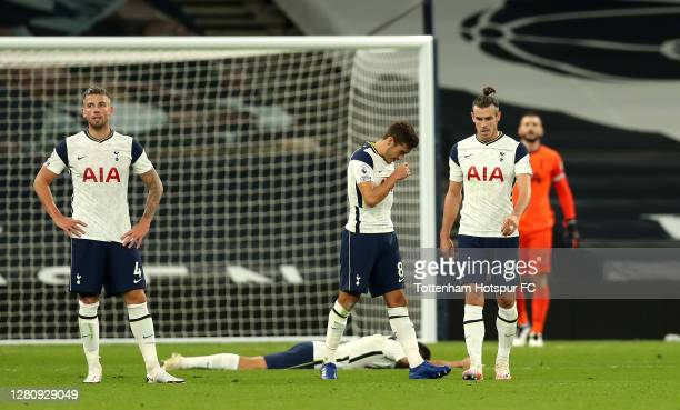 Tottenham Hotspur players look dejected after conceding a third goal during the Premier League match between Tottenham Hotspur and West Ham United at...