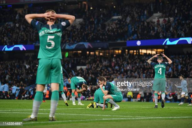 Tottenham Hotspur players look dejected after Manchester City's fifth goal before it is later disallowed during the UEFA Champions League Quarter...