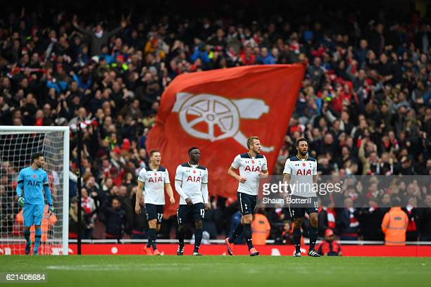 Tottenham Hotspur players look on after conceding their first goal during the Premier League match between Arsenal and Tottenham Hotspur at Emirates...