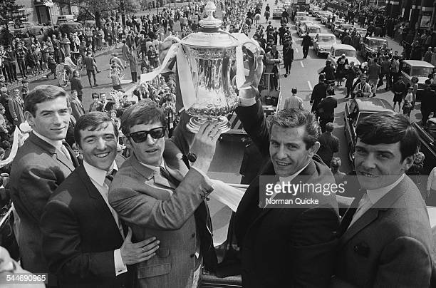 Pat Jennings Terry Venables Jimmy Robertson Alan Mullery and Cyrille Knowles display the FA Cup trophy to jubilant fans from an open top bus en route...