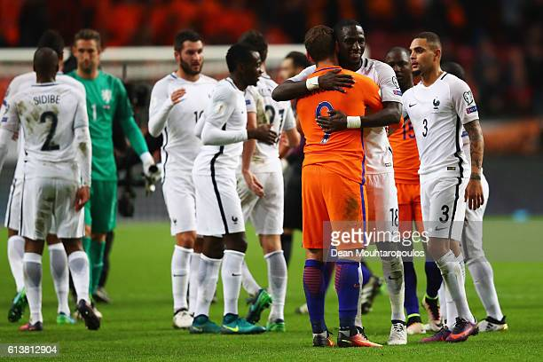 Tottenham Hotspur players Moussa Sissoko of France and Vincent Janssen of the Netherlands embrace after the FIFA 2018 World Cup Qualifier between...