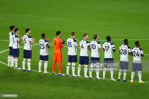 Tottenham Hotspur players observe a minutes applause for former England player Ray Clemence, who recently passed away following a battle with...