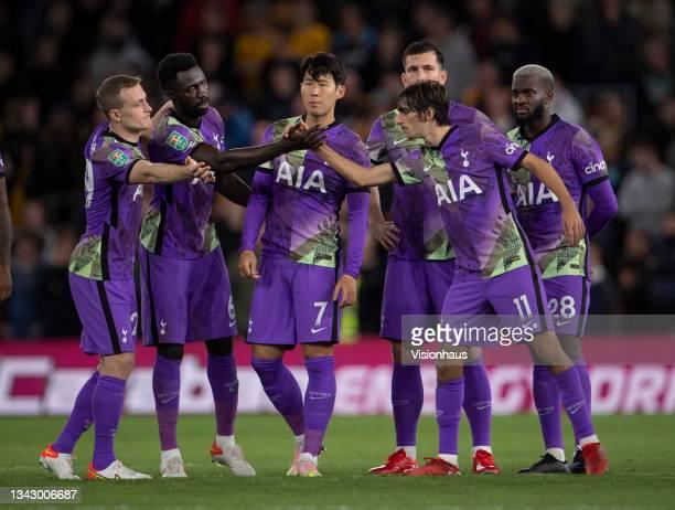 Tottenham Hotspur players Oliver Skipp, Davinson Sanchez, Heung-Min Son, Pierre-Emile Højbjerg and Tanguy Ndombele congratulate team mate Bryan Gil...