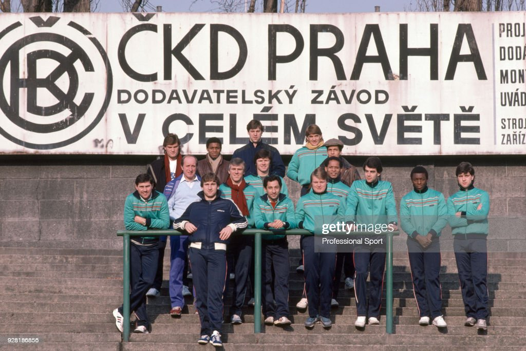 Tottenham Hotspur players pose for a group photo in the stadium before their UEFA Cup 3rd round 2nd leg against Bohemians Praha at the olíek Stadium on December 12, 1984 in Prague, Czechoslovakia. Back row (left-right): Glenn Hoddle, Danny Thomas, Tony Galvin, Gary Mabbutt. Centre row, standing behind rail: Paul Miller, Peter Shreeves, Graham Roberts, Steve Perryman, Ossie Ardiles, Garry Brooke, John Chiedozie, Chris Hughton (wearing cap), Gary Stevens, Garth Crooks, Mark Bowen. In front, dark blue tracksuit: Mark Falco.