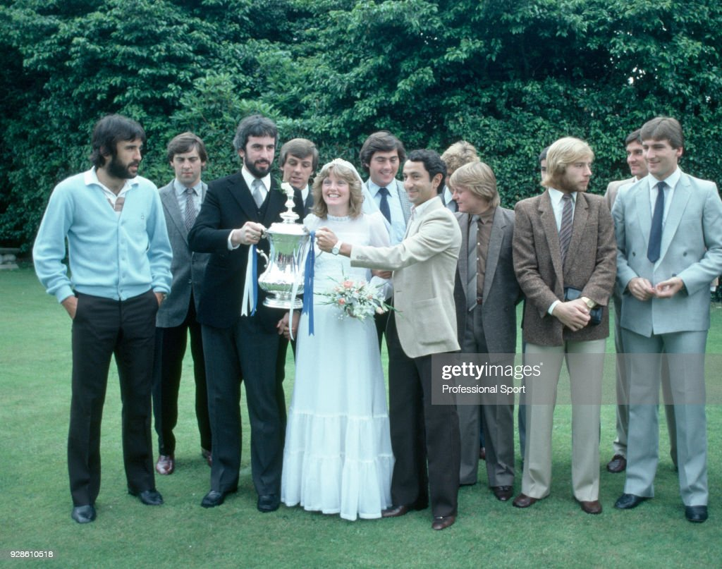 Tottenham Hotspur players showcase the FA Cup at a Wedding in Ireland while on tour, circa July 1981. Tottenham players (left-right): Ricky Villa, Tony Galvin, (Bride and Groom) Graham Roberts, Paul Miller, Ossie Ardiles, Garry Brooke, Steve Archibald, Milija Aleksic and Mark Falco.