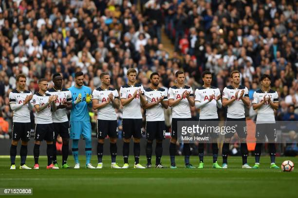 Tottenham Hotspur players stand during the minutes appluse for Ugo Ehiogu prior to The Emirates FA Cup SemiFinal between Chelsea and Tottenham...