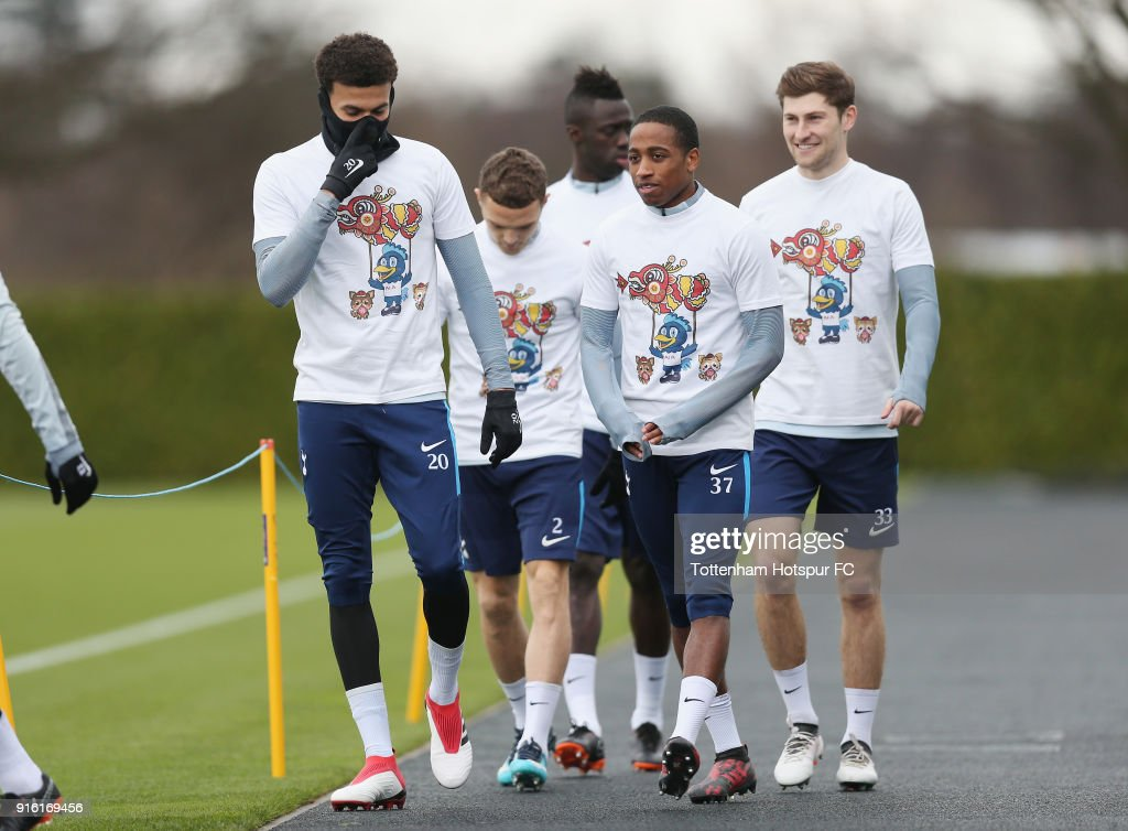 Tottenham Hotspur players walk out for training in Chinese New Year t-shirts ahead of the north london derby during the Tottenham Hotspur training session at Tottenham Hotspur Training Centre on February 9, 2018 in Enfield, England.