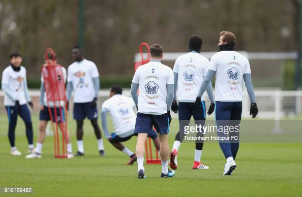 Tottenham Hotspur players walk out for training in Chinese New Year tshirts ahead of the north london derby during the Tottenham Hotspur training...