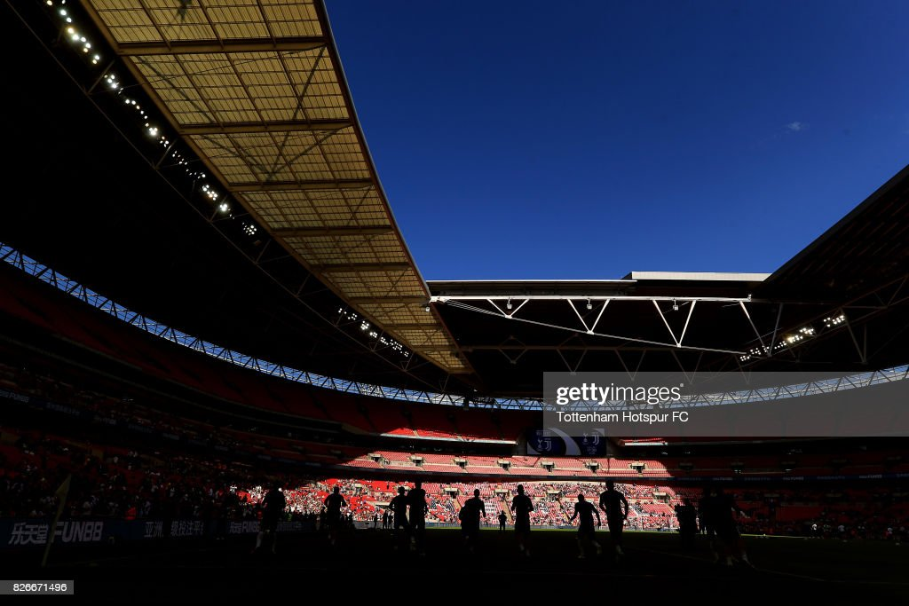 Tottenham Hotspur players warm up ahead of the Pre-Season Friendly match between Tottenham Hotspur and Juventus at Wembley Stadium on August 5, 2017 in London, England.