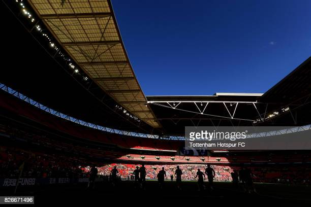 Tottenham Hotspur players warm up ahead of the PreSeason Friendly match between Tottenham Hotspur and Juventus at Wembley Stadium on August 5 2017 in...