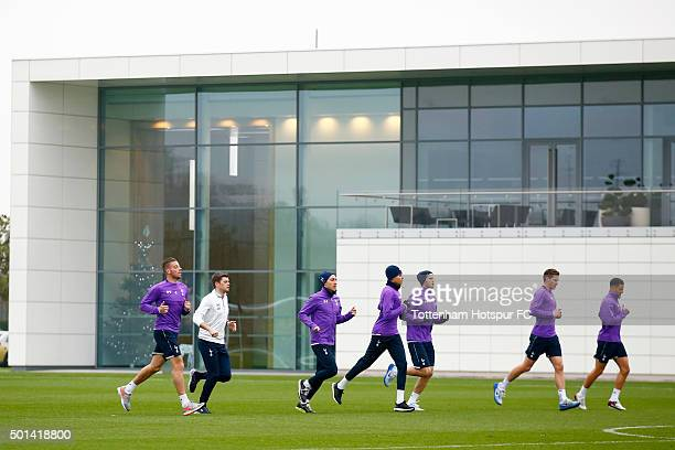 Tottenham Hotspur players warm up during a training session at the club's training ground on December 15 2015 in Enfield England