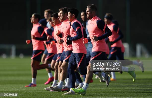 Tottenham Hotspur players warm up during the Tottenham Hotspur training session at Tottenham Hotspur Training Centre on October 15, 2020 in Enfield,...