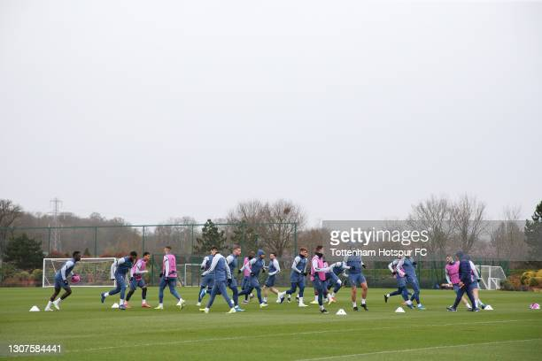 Tottenham Hotspur players warm up during the Tottenham Hotspur training session at Tottenham Hotspur Training Centre on March 17, 2021 in Enfield,...