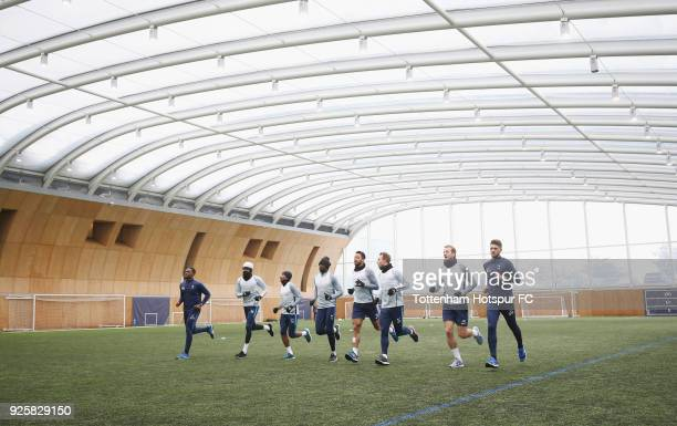 Tottenham Hotspur players warm up during the Tottenham Hotspur training session at Tottenham Hotspur Training Centre on March 1, 2018 in Enfield,...