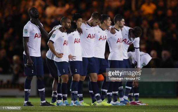 Tottenham Hotspur players watch the penalty shootout during the Carabao Cup Third Round match between Tottenham Hotspur and Colchester United at...
