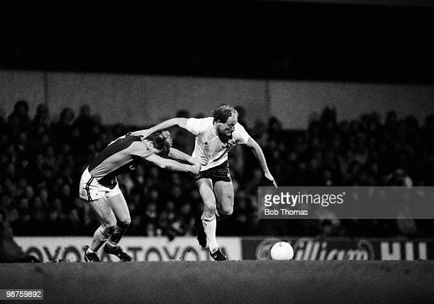 Tottenham Hotspur striker Alan Brazil holds off a challenge from Ken McNaught of Aston Villa during the Division One League match held at White Hart...
