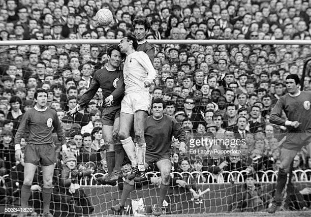 Tottenham Hotspur striker Alan Gilzean is challenged by Tommy Smith and Geoff Strong of Liverpool watched by Chris Lawler goalkeeper Tommy Lawrence...