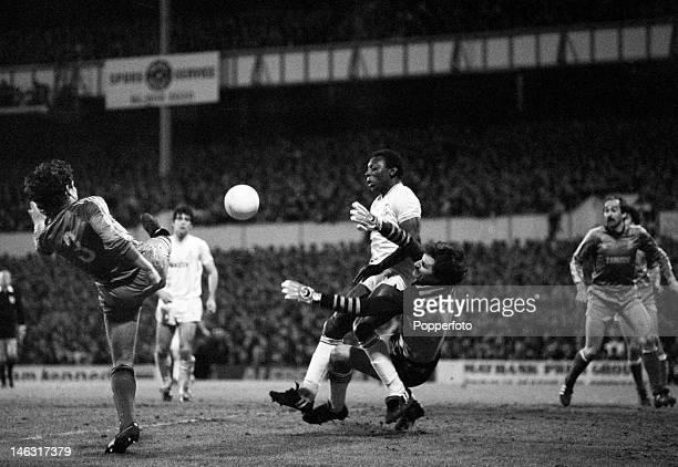 Tottenham Hotspur striker Garth Crooks causes problems for the Real Madrid goalkeeper Miguel Angel and defender Jose Antonio Camacho during the UEFA...