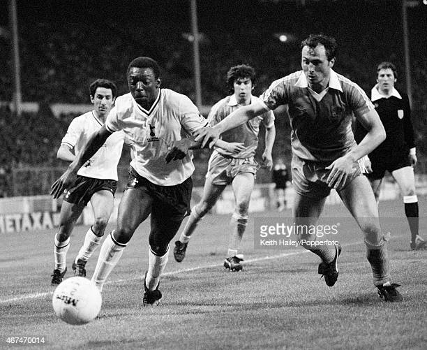 Tottenham Hotspur striker Garth Crooks is challenged by Manchester City fullback Bobby McDonald during the FA Cup Final Replay at Wembley Stadium in...