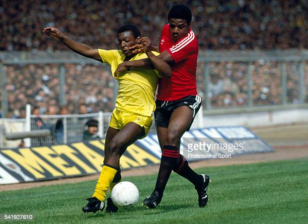 Tottenham Hotspur striker Garth Crooks is challenged by Queens Park Rangers defender Bob Hazell during the FA Cup Final at Wembley 22nd May 1982