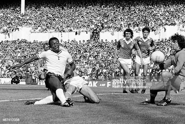 Tottenham Hotspur striker Garth Crooks scores their first goal during the 1st Division match between Tottenham Hotspur and Brighton Hove Albion at...