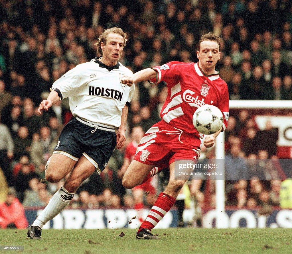 Tottenham Hotspur striker Jurgen Klinsmann (left) challenges Liverpool defender Rob Jones during the FA Cup 6th round match at Anfield in Liverpool, 11th March 1995. Tottenham Hotspur won 2-1.