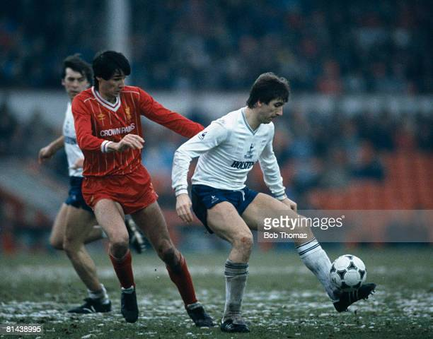 Tottenham Hotspur striker Mark Falco controls the ball under pressure from Liverpool defender Alan Hansen on a snowy Anfield pitch during their 1st...