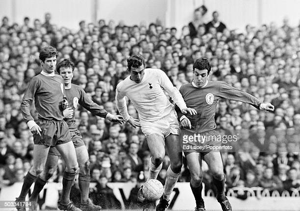 Tottenham Hotspur striker Martin Chivers is challenged by Ian Callaghan of Liverpool, watched by Geoff Strong and Tommy Smith, during their match at...
