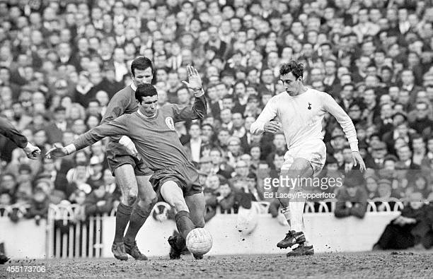 Tottenham Hotspur striker Martin Chivers plays the ball past Liverpool captain Ron Yeats watched by Tommy Smith during their FA Cup 5th round match...