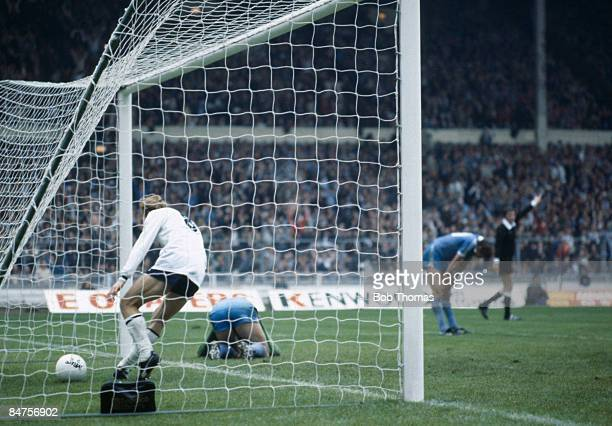 Tottenham Hotspur striker Steve Archibald collects the ball after Glenn Hoddle's shot had been deflected by Manchester City's Tommy Hutchison past...