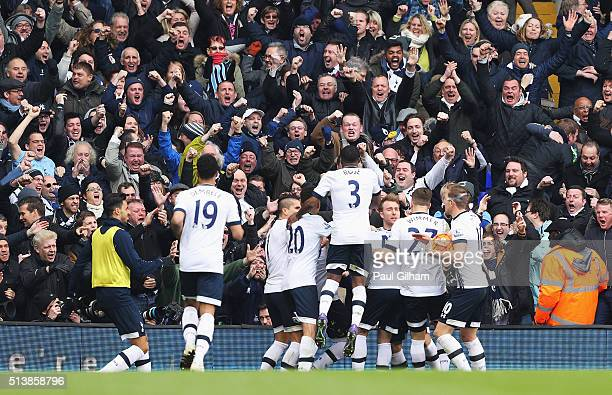 Tottenham HOtspur supporters celebrate their team's first goal during the Barclays Premier League match between Tottenham Hotspur and Arsenal at...