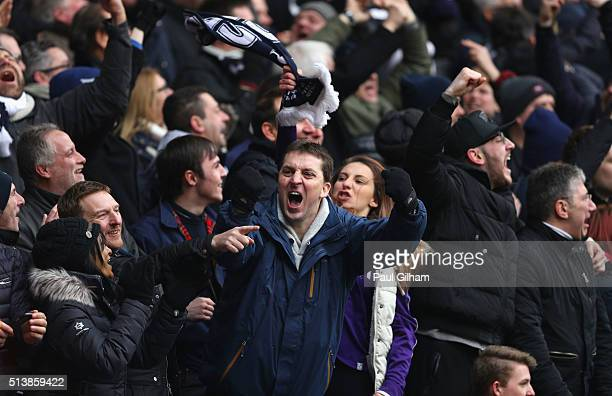 Tottenham Hotspur supporters celebrate their team's second goal during the Barclays Premier League match between Tottenham Hotspur and Arsenal at...
