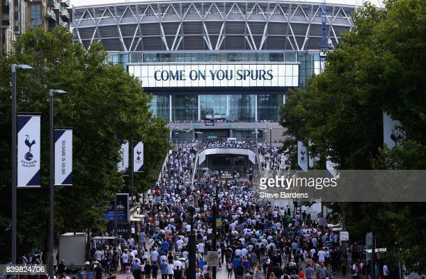 Tottenham Hotspur supporters walk the Olympic Way to the Wembly Stadium prior to the Premier League match between Tottenham Hotspur and Burnley at...