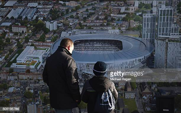 Tottenham Hotspur supporters watch the new stadium plan picture prior to the Barclays Premier League match between Tottenham Hotspur and Sunderland...