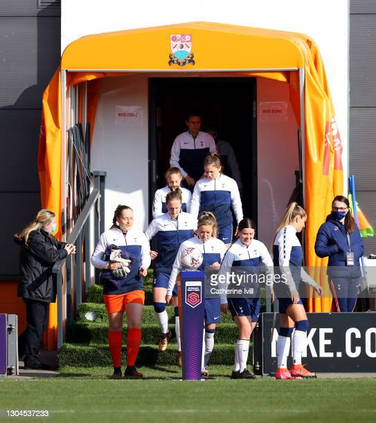 Tottenham Hotspur team enter the pitch through the tunnel prior to the Barclays FA Women's Super League match between Tottenham Hotspur Women and...