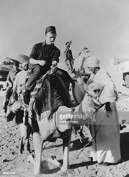 Tottenham Hotspur winger Terry Dyson riding a camel during a sightseeing visit to the pyramids at El Giza Egypt 15th November 1962 Spurs were in...