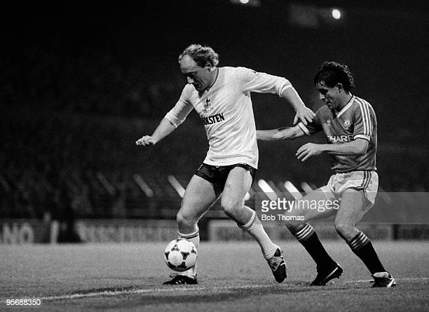 Tottenham Hotspur's Alan Brazil holds off a challenge from Manchester United's Arthur Albiston during their Division One football match held at Old...
