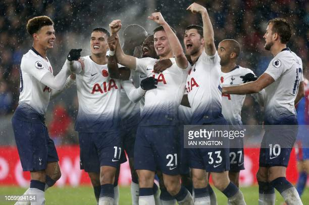 Tottenham Hotspur's Argentinian defender Juan Foyth celebrates with teammates after scoring the opening goal of the English Premier League football...