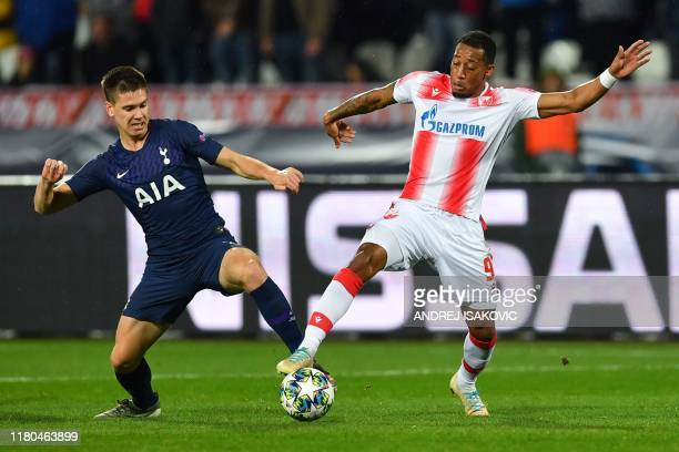 Tottenham Hotspur's Argentinian defender Juan Foyth fights for the ball with Red Star Belgrade's Dutch midfielder Rajiv Van la Parra during the UEFA...