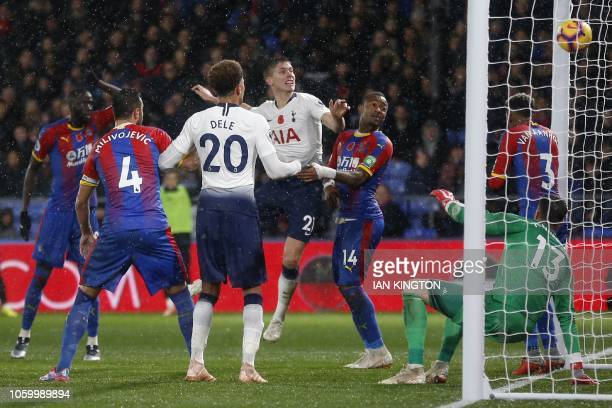 Tottenham Hotspur's Argentinian defender Juan Foyth heads in the opening goal of the English Premier League football match between Crystal Palace and...