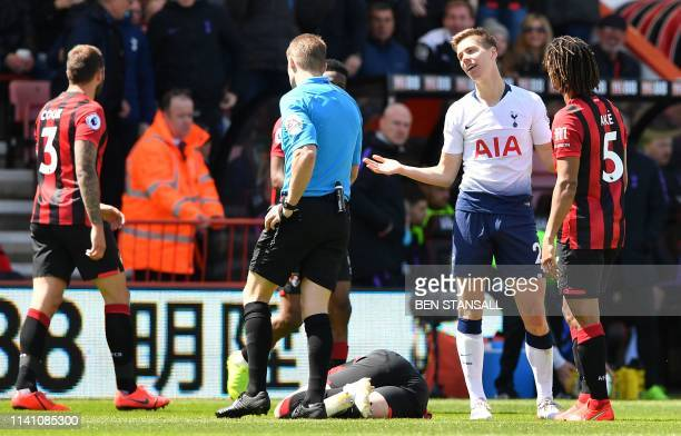 Tottenham Hotspur's Argentinian defender Juan Foyth remonstrates with referee Craig Pawson after receiving a red card for his challenge on...