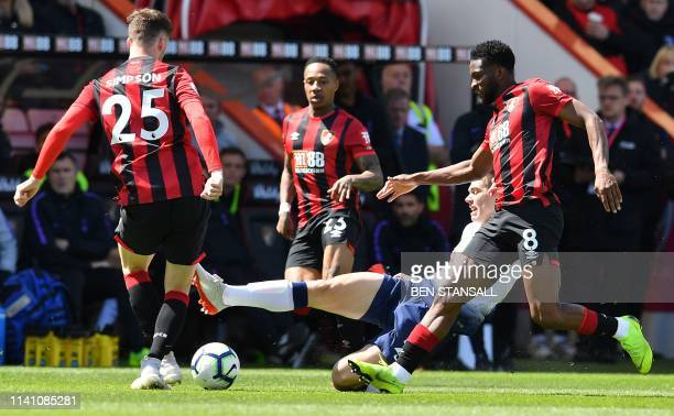 Tottenham Hotspur's Argentinian defender Juan Foyth vies with Bournemouth's English defender Jack Simpson and Bournemouth's Colombian midfielder...