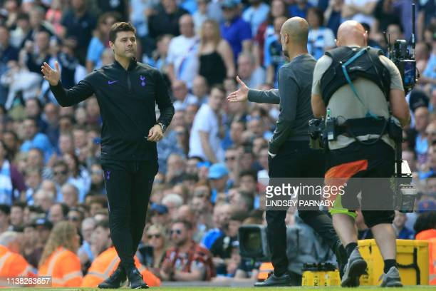 Tottenham Hotspur's Argentinian head coach Mauricio Pochettino and Manchester City's Spanish manager Pep Guardiola gesture at the final whistle...